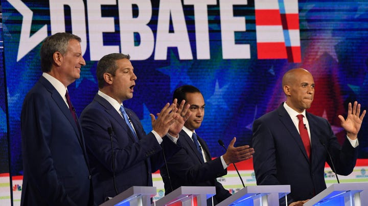 Mayor of New York City Bill de Blasio, Rep. Tim Ryan, D-Ohio, Former Secretary of Housing and Urban Development Julian Castro and Sen. Cory Booker, D- N.J., participate in the first Democratic primary debate in Miami on June 26, 2019.