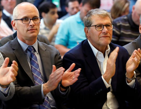 UConn men's basketball coach Dan Hurley, left, and women's basketball coach Geno Auriemma applaud the announcement that the school is re-joining the Big East Conference.