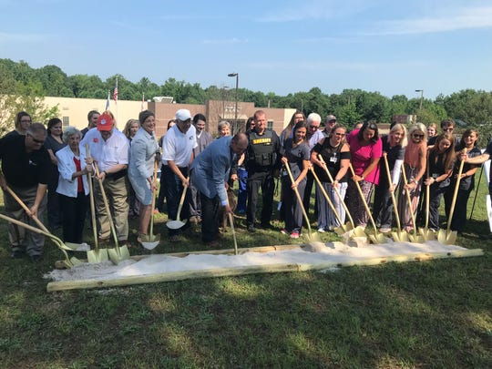County officials, staff of Anderson County P.A.W.S. and donors shovel sand at the groundbreaking ceremony for the facility's new dog and community park June 28. Gunner, a 3-year-old labrador and explosives detector at the Anderson County Sheriff's Office, assisted.