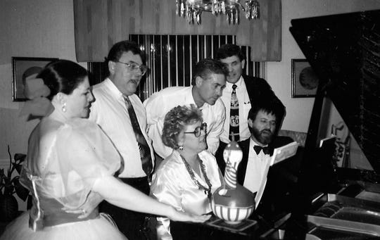 From left: Patti Holloway, Dr. Carl Trusler, Jayne Middleton (at the piano), John Weeks, Jess Holloway and Glenn Dromgoole belt out the tunes. Trusler was known for his singing voice.