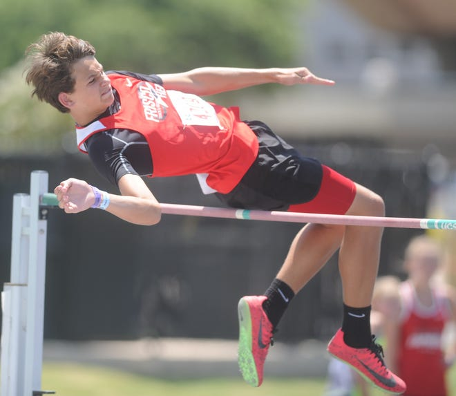 Colston Adamson, 13, clears 5 feet, 6 inches in the high jump at the Amateur Athletic Union Junior Olympic Games qualifier Friday at Abilene Christian's Elmer Gray Stadium. Adamson won the event to advance to nationals.