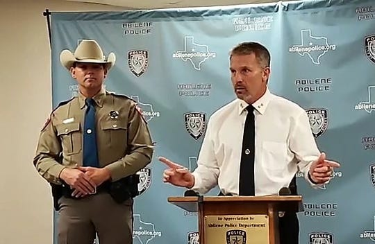 Abilene Police Chief Stan Standridge, right, and DPS Trooper Casey Smith on Friday at the Law Enforcement Center discuss the arrests of 13 in online child sex sting operation.
