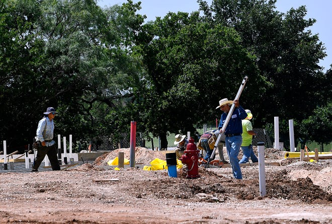 Workers Friday construct the foundation for Allen Ridge, a multipurpose shopping and residential project on Judge Ely Boulevard,  across from Abilene Christian University.