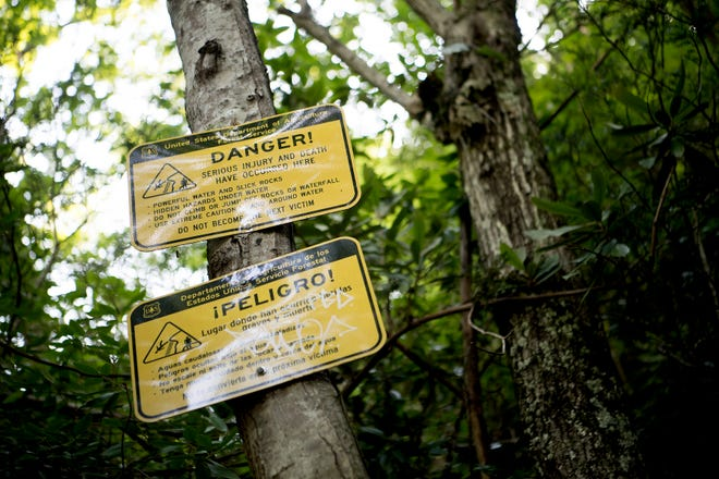 Signs warn of danger to the side of Catawba Falls in the Pisgah National Forest in Old Fort on June 28, 2019.