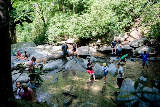 Visitors play in the pools at the base of Catawba Falls in the Pisgah National Forest in Old Fort on June 28, 2019.