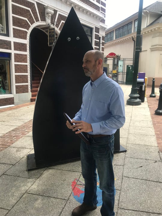 Democratic N.C. Senate candidate Ben Scales speaks at a June 28, 2019, press conference in front of the Flat Iron sculpture near the building of the same name. Scales criticized the planned conversion of the historic building into a hotel.