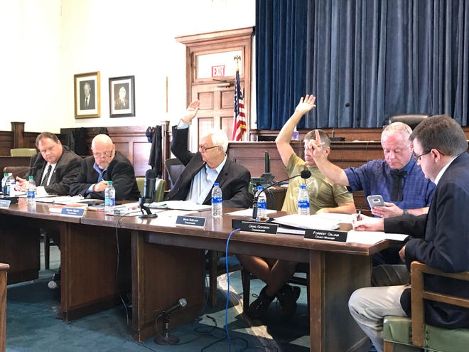 Madison County Commissioners Norris Gentry, Mark Snelson and Craig Goforth vote in favor of the 2019-20 budget that includes a 3-cent property tax increase.