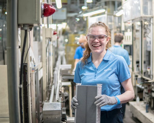 Mahala Worthington works on heating coils at Denso. She was their first employee to graduate from their Adult Education Program.