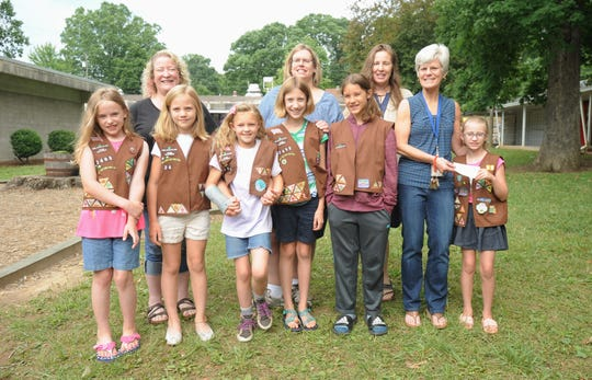 The Brownies of Girl Scout Troop 02498 presented a check for $405 to cover unpaid lunch balances at Black Mountain Primary School on June 12. Front row, left to right: Wren Hall, Haleyanne Duvall, Charlotte Pauly, Ellison Duvall, Ruby Sednick, Black Mountain primary principal Malorie McGinnis and Paislee Cordell. Back row, left to right: Cafeteria managers Jen Mohr, Nancy Hunt and troop leader Kiersten Hall.