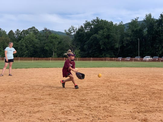Owen 6U All-Star team member Kinslee Young fields a ground ball at Veterans Park as coach Heather Godfrey looks on. The all-star team will compete in the state championship tournament in Marion on July 4 weekend after finishing second in the District 2 tournament on June 20.