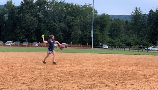 Karter McIntosh, a member of the Owen 6U All-Stars softball team makes a throw in practice, as her team prepares for the state championship tournament in Marion.