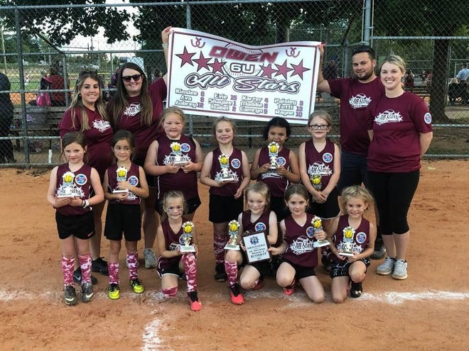The Owen 6U All-Star softball team celebrates its second place finish in the District 2 tournament on June 20. Kneeling, from left to right: Camryn Davidson, Evie Wiggs, Maddie Boone and Kinslee Young. Standing, from left to right: Karter McIntosh, Isabel Watkin, Aubrey Hutchins, Shaylee Branch, Tutti Priester and Ava Godfrey. Back row, left to right: Coaches Kristi Young, Tara Hutchins, Jarod McIntosh and Heather Godfrey.