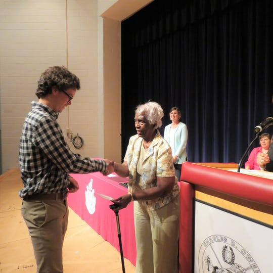 Brandon Nightingale receives his scholarship from Sylvia Carpenter, the chair of the Swannanoa Valley Dr. Martin Luther King, Jr. Memorial Corp. scholarship subcommittee.