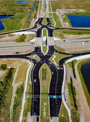 "This aerial view from April shows the Viera Boulevard ""diverging diamond"" Interstate 95 interchange under construction."