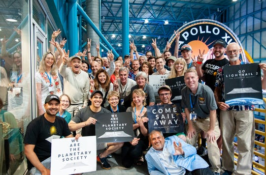 Bill Nye surrounded by members of The Planetary Society at the launch of LightSail 2 aboard the SpaceX Falcon Heavy.