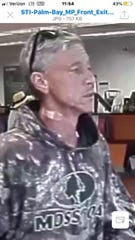 Palm Bay police are searching for the suspect who they say robbed the Palm Bay Road Suntrust Friday.