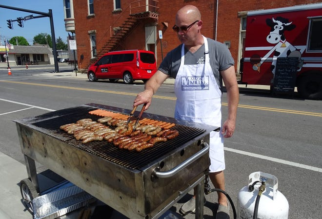 Jeff Norman mans the grill for Mizick Miller & Co. during the ninth annual South of the Square Block Rally in 2019. The 2020 event was canceled because of the COVID-19 pandemic.