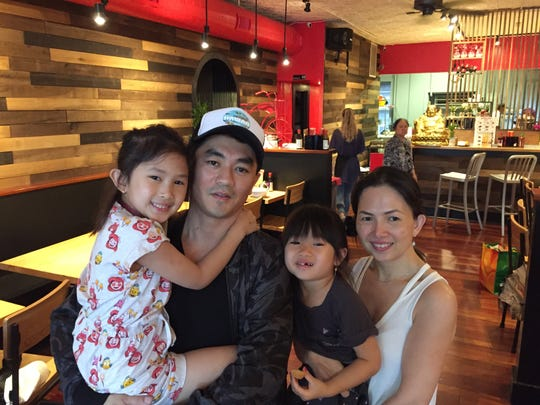 From left to right, Jessica Le-Tien, 6; Lam-Son Le-Tien; Vanessa Le-Tien, 4; and Jennie Yee in the family's Pho Son restaurant in Burlington on June 25, 2019.