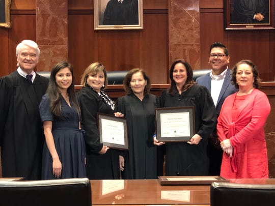 "The 214th District Court and the 347th District Court were recognized as ""Centers of Excellence"" in Austin on June 28. 2019."