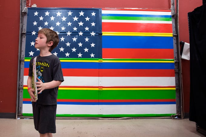 "Joseph Andrews, 6, views the mural ""Latinos Unidos,"" which is translated United Latins, during an unveiling of the mural on Friday, June 28, 2019 at the Antonio E. Garcia Arts & Education Center. The mural is one of two that Mayra Zamora designed and painted at the center with the help of teens."