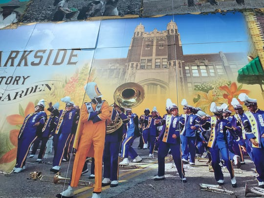 The mural pays tribute to Camden High, the Castle on the Hill, and its Mighty Panthers Marching Band, as well as famous Parkside eateries Donkey's Place and Corinne's Place.