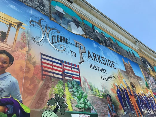 The mural on the back of the Camden County Historical Society also serves as a welcome for visitors to the Parkside History Garden, where heirloom saplings from its original orchard are growing.