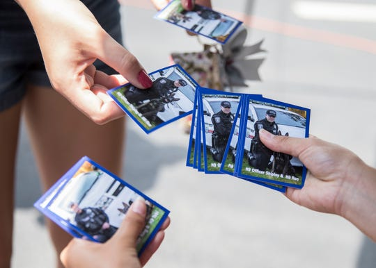 Baseball style cards with pictures of Roo and Tobi were handed out to those wanting to see Rin and his partner Officer Simmons at the downtown McDonalds Thursday morning. Rin's cards are still in the works to be made.