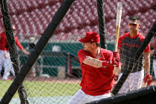 Cincinnati Reds second baseman Scooter Gennett (3) stands in the cage for a round of batting practice before the MLB National League game between the Cincinnati Reds and the Chicago Cubs at Great American Ball Park in downtown Cincinnati on Friday, June 28, 2019.