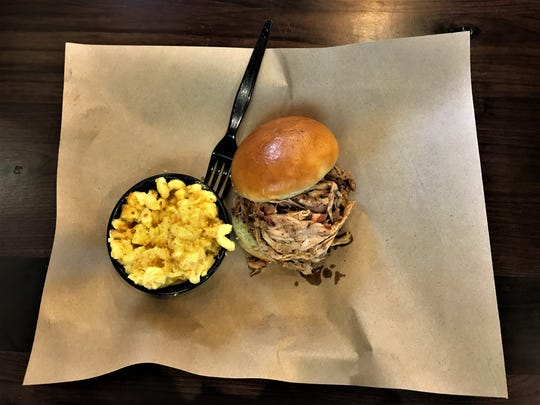 Pulled pork overflows out of this sandwich at Mission BBQ in Deerfield Township.