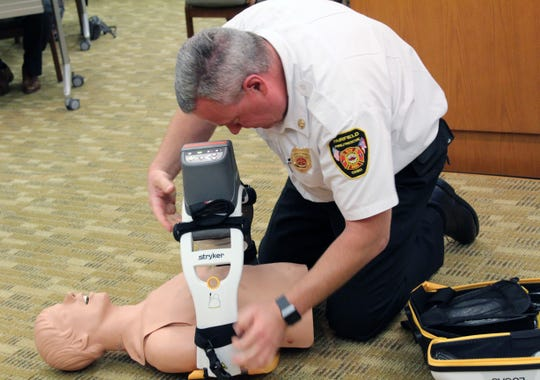 Fairfield Deputy Fire Chief Tom Wagner demonstrates how a patient would be hooked up to a Lucas device that delivers chest compression. The Mercy Health Foundation is donating $20,000 for the purchase of one of the two the city will order.