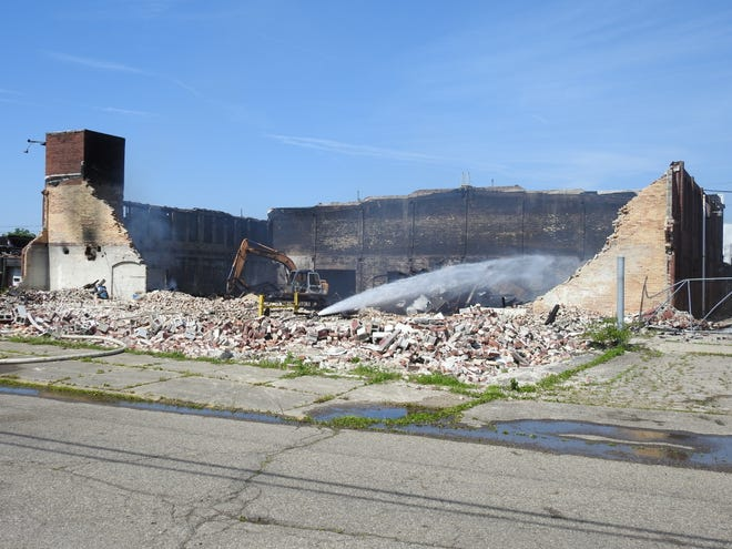 The City of Coshocton is working with owner Eric Baker on securing the former Ansell-Edmont building and pursuing demolition. A fire on June 27 ravaged the compounding building of the industrial glove maker that closed in 2011.