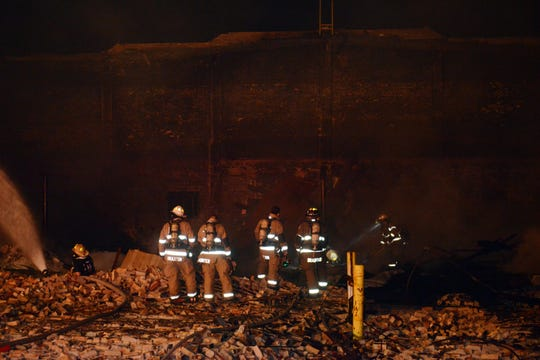 Coshocton Fire Department personnel fight a fire late Thursday at the former Ansell-Edmont factory. The property, located on the corner of Walnut and 14th streets, had been vacant since 2011.