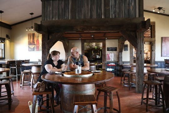 Crystal and Paul Sipe of Dresden enjoy a glass of wine at Indian Bear Winery in Walhonding, west of Coshocton.