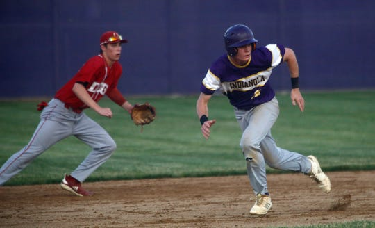 Indianola junior Aidan Freshly breaks toward third on the way to scoring. Indianola lost at home to Dallas Center-Grimes 8-2 on June 26.