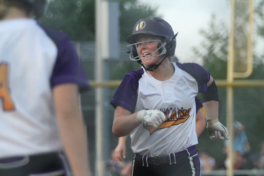 Indianola senior Emily Chaplin scores on a home run by junior Kassie Baker. Indianola beat Dallas Center-Grimes 10-0 in a June 26 home game.