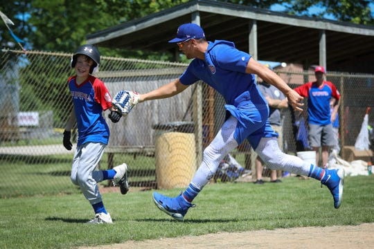 Iowa Cubs outfielder Jacob Hannemann tries to tag a runner during the Iowa Baseball Camp for the Deaf.