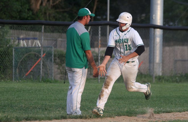 Southeast Warren senior Colby Page rounds third base after hitting a home run.