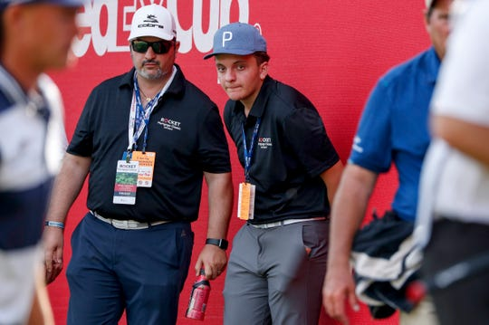 Anthony Trudel, 15, center, watches action from the sidelines during the Rocket Mortgage Classic at the Detroit Golf Club in Detroit on Friday, June 28, 2019.