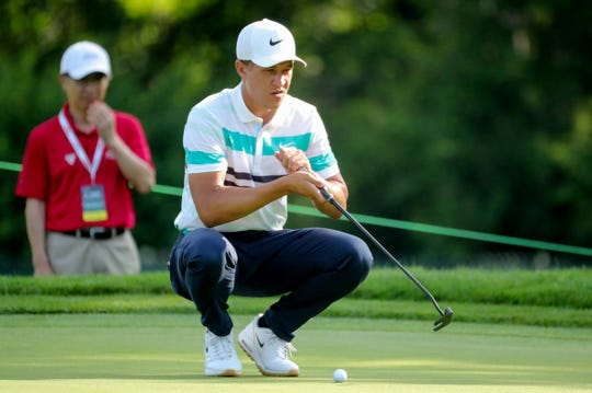 Cameron Champ lines up his shot on the fifth hole during the second round of the Rocket Mortgage Classic at the Detroit Golf Club in Detroit on Friday, June 28, 2019.