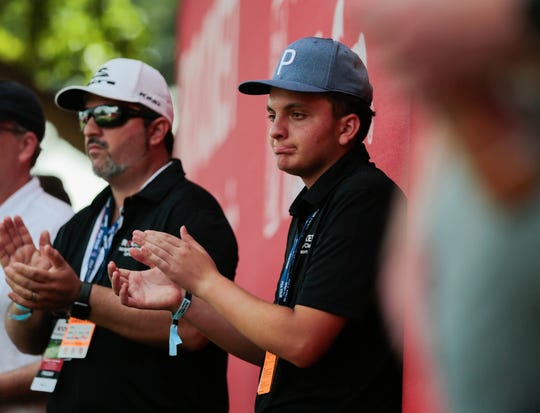 Anthony Trudel, 15, of Parkland, Fla. claps for Rickie Fowler during the Rocket Mortgage Classic at the Detroit Golf Club in Detroit on Friday, June 28, 2019.