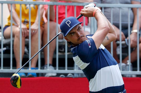 Rickie Fowler tees off at the first hole Friday.