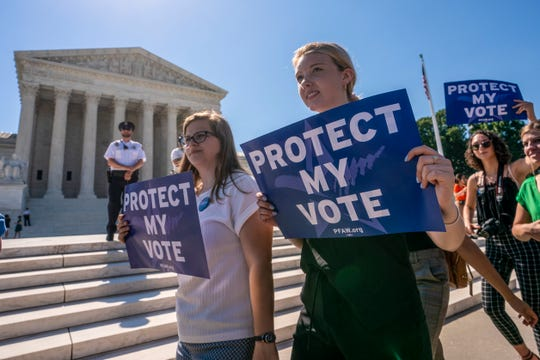Demonstrators gather at the Supreme Court as the justices finish the term with key decisions on gerrymandering and a census case involving an attempt by the Trump administration to ask everyone about their citizenship status in the 2020 census.
