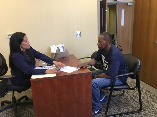 Project Clean Slate attorney Kavita Uppal, a former assistant Wayne County Prosecutor, helps Gary Taylor of Detroit with his expungement application at a City of Detroit office at the Northwest Activities Center on the city's northwest side.