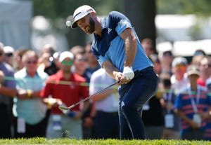 Dustin Johnson hits onto the 11th green during the first round of the Rocket Mortgage Classic on Thursday.