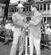 Joe Louis shakes hands with Byron Nelson, right, at the Tam O'Shanter Open Golf Tournament at the Suburban Chicago Course on July 22, 1943.   Louis was on furlough from Army duties during World War II.