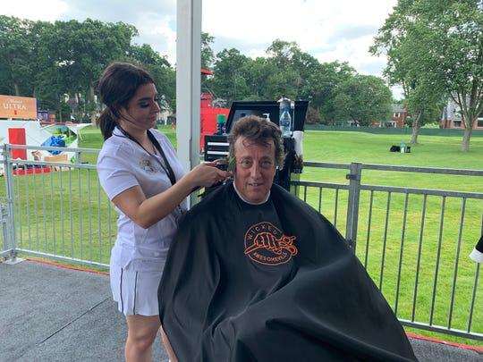 Frank Worden gets a free haircut Friday at the Rocket Mortgage Classic.