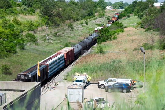A freight train that derailed in an international tunnel connecting Michigan and Canada, sits on the track, Friday, June 28, 2019, in Port Huron.