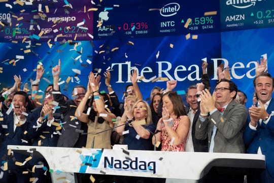 Julie Wainwright, center, CEO of The RealReal, celebrates her company's IPO at the Nasdaq opening bell, Friday, June 28, 2019 in New York.