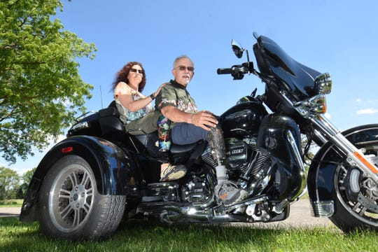 Wendy and Dave Ramirez of Dexter both lost part of their legs in a 2002 motorcycle crash when an auto driver swerved across a median line and struck them.  They still ride, on their Harley-Davidson trike.