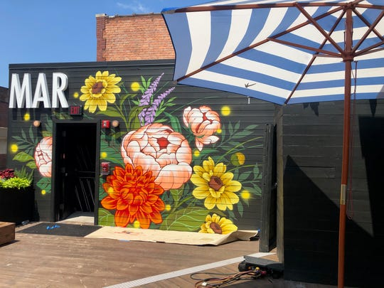 A floral mural at rooftop bar and lounge Delmar, now open in Greektown.